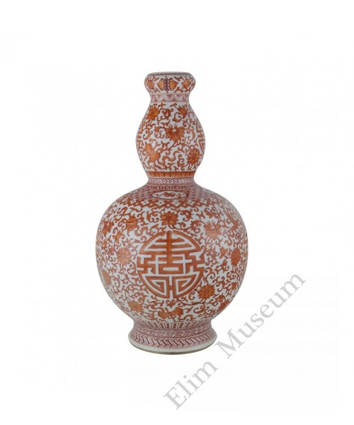 1120   A n  iron-red  gourd vase with blessing symbols