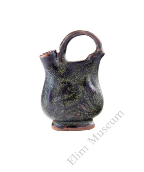 1142 A Song Dynasty Wu-Zhou ware black teadust cockscomb vase