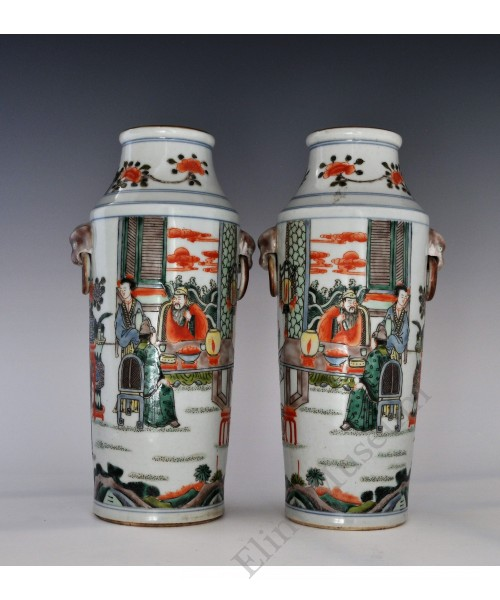 1667 A Wucai figures dragon handled pair vases