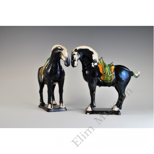 1684 A Pair of Molded and Sculpted Horse with Saddles