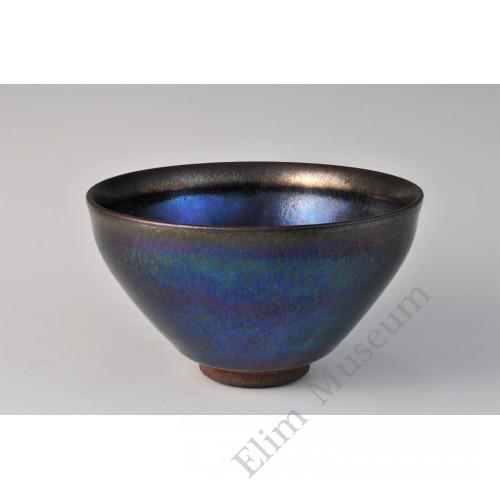 1699  A Jian stone-ware iridescent black glaze conical tea bowl