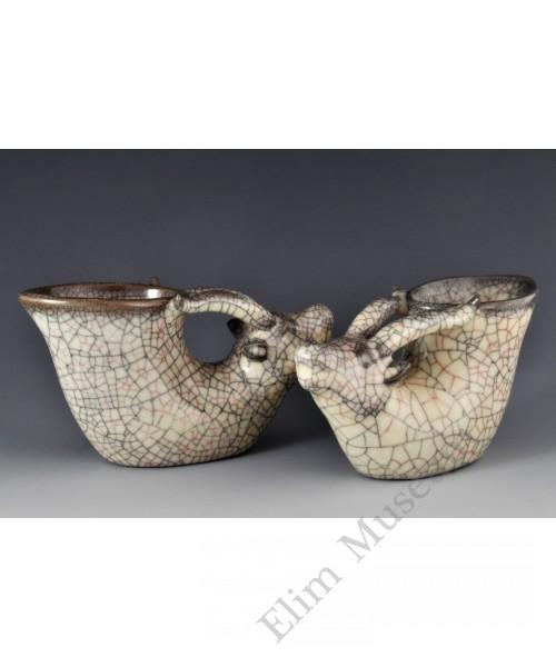 1713 A Pair of Ge-ware ivory glaze dear shape vine cups