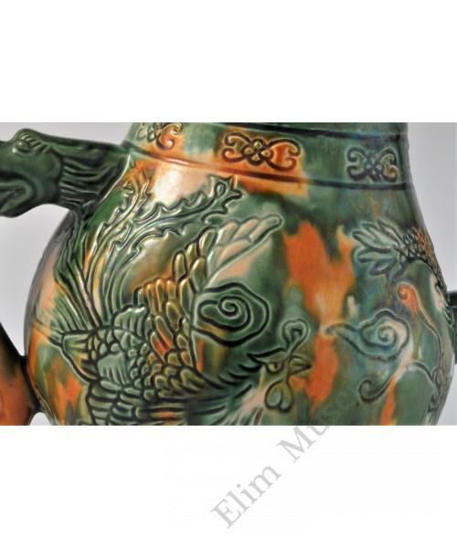 1721 A Sancai teapot incised with dragon & phoenix