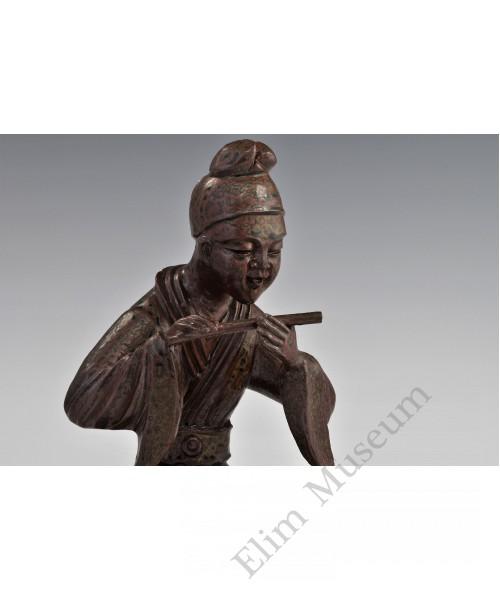 1725 A greem glazed sculpted earthenware musician