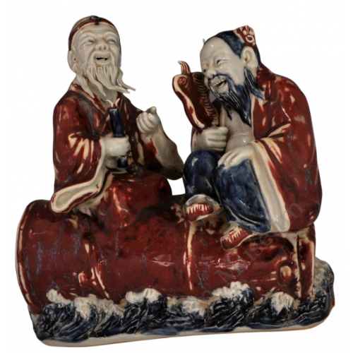 """1731 A sculpture in under glaze blue & red of figures of the """"Eight Immortals"""""""