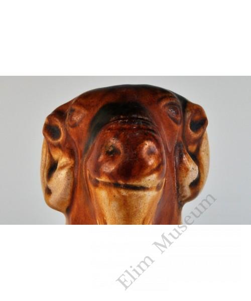1752 A sculpted Sancai earthware recumbent sheep