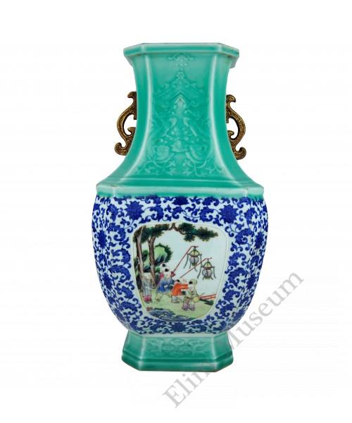 1209  A carved celadon underglaze-blue fencai vase