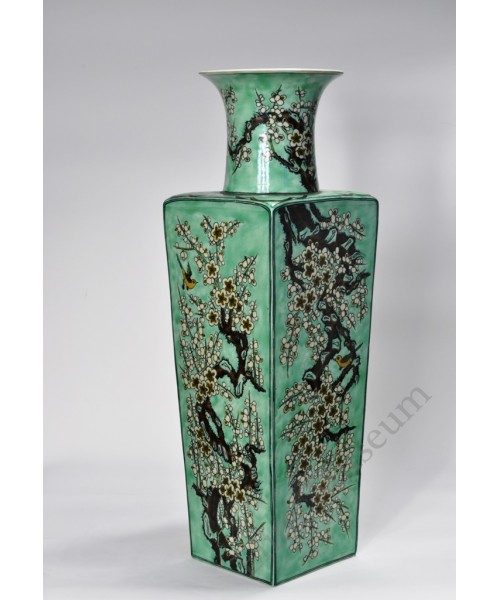 1043  A Sancai vase with plums and  orioles.