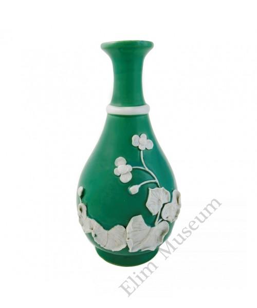 1048  A green glaze Yuhuchun vase with molded lotus